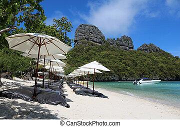 White umbrella and air cushion seat on the beach
