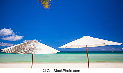 White umbrella at the beach