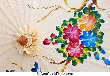 White umbrella handmade in Chiang Mai, Thailand.