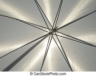 White umbrella with metal lines on a sunny day