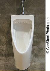 White urinals in the men's bathroom of interior decoration.