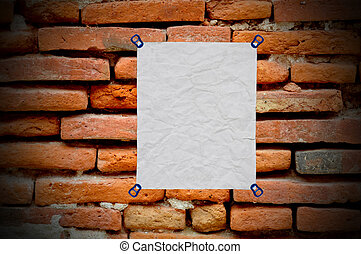 white used paper on on brick wall background