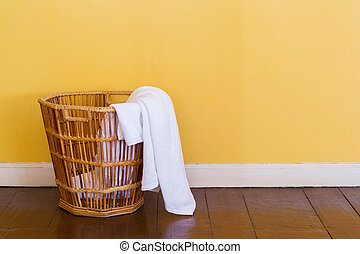 White used towels in wicker basket - Close up white color...