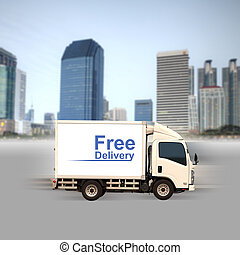 White van with Free delivery and office buildings in the city