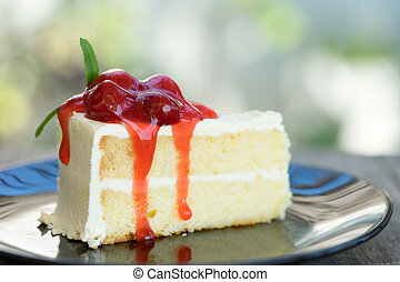 White vanilla cake with raspberry jam topping