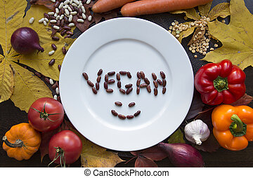 White vegan plate with various vegetables top view