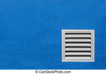 White Vent on Blue Concrete Wall