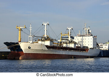 White vessel - The white vessel costs at a mooring