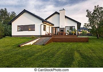White villa with patio