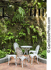 White vintage chairs in the garden
