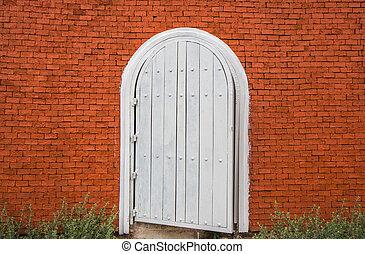 white vintage door on brick wall