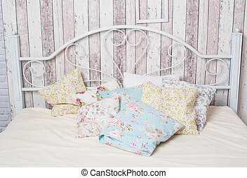 white vintage double bed in the bedroom
