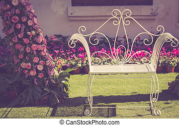 White vintage metal chair in the garden