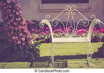 White vintage metal chair in the garden