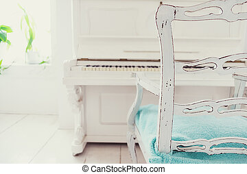 White vintage piano in a white room