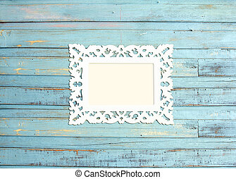 White Vintage picture frame, wood plated, blue wood background, clipping path included