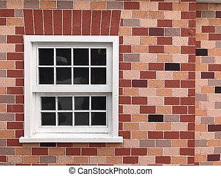 white vintage window on brick wall