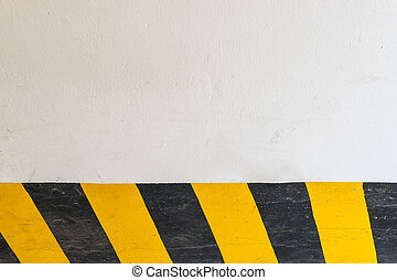 White wall and yellow black stripe background.