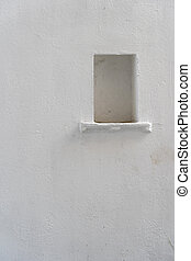 White wall background with a niche in Udaipur, Rajasthan, India. Close up, copy space