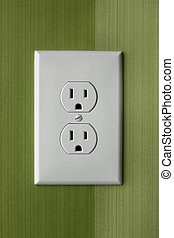 close up of white electrical wall outlet with wallpaper