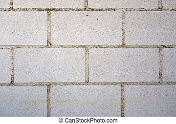 White wall with cement bricks