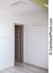 White walls and wooden door - Close-up of white walls and ...
