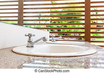 White wash basin - White ceramic wash basin in restroom