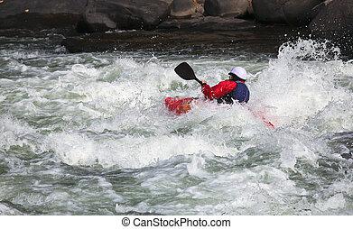 White water kayaking - Canoeing in white water in rapids on...