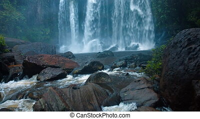 Veil of White Water Tumbles over the Brink of a Natural Park at Phnom Kulen in Cambodia, with Sound. Full HD video