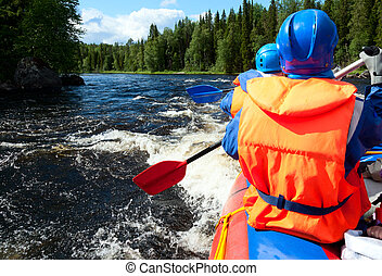 White water rafting - Rafters in a rafting boat on Pistojoki...