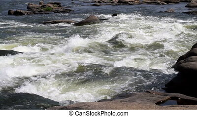 White Water Rapids - Rushing white water rapids swirls...