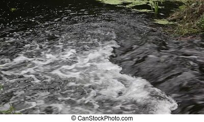 White water rushing down a water fa - Fast flowing water at...