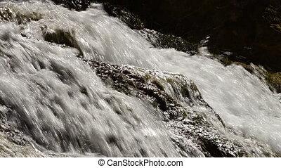 White water rushing over travertine rocks waterfall. -...