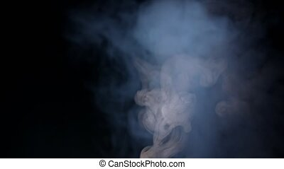 White Water Vapour on a Black Background. - White water...