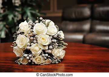 white wedding bouquet of roses