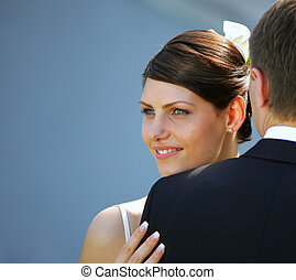 Bride and groom newlyweds seen here on their wedding day, Bride is wering a traditional white wedding dress