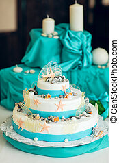 White wedding cake decorated with seashells - White and blue...