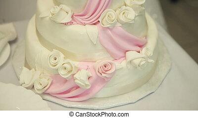White wedding cake on the table