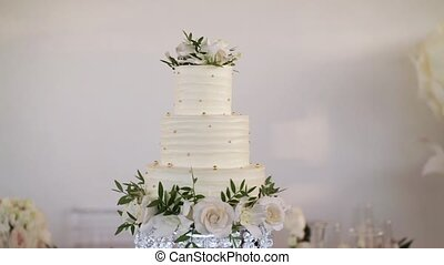 White wedding cake slowmotion pan