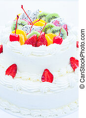 White wedding cake topped with fruit. Selective focus