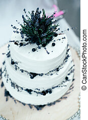 White wedding cake with blackberries,