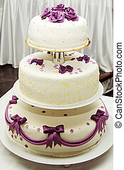 White wedding cake with purple flower detail
