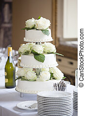 White wedding cake with roses