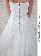 View of the back, beautiful openwork patterns, lace - decorated top dresses, waist, long zip with buttons.