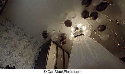 wedding dress hanging on the chandelier