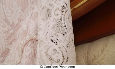 White wedding dress in bedroom at sunny day