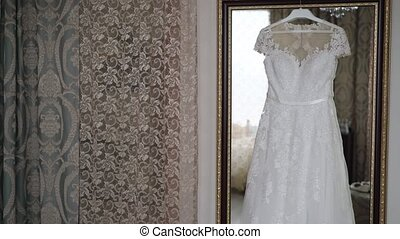 White wedding dress in room