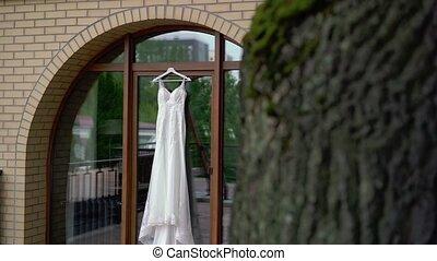 White wedding dress on terrace