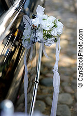 White wedding floral decoration on the car door