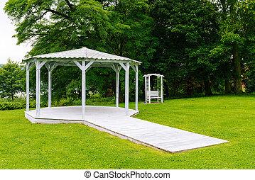 white wedding gazebo in the old park